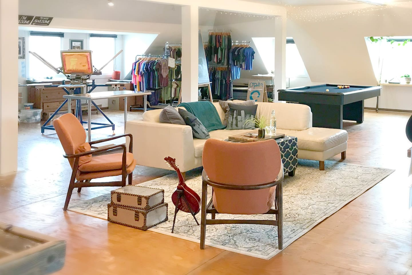 Come and relax! Our spacious loft houses a pool table, comfy living room, 2 sleeping areas, our screen printing press, and our many work spaces.