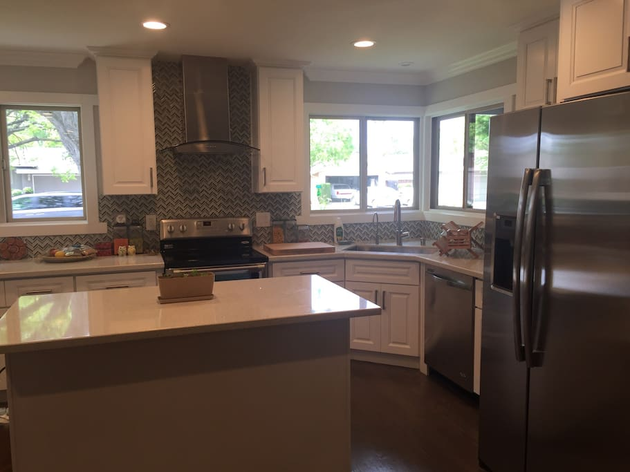 Beautiful, stylish kitchen with view of front yard. Reverse osmosis water filter.