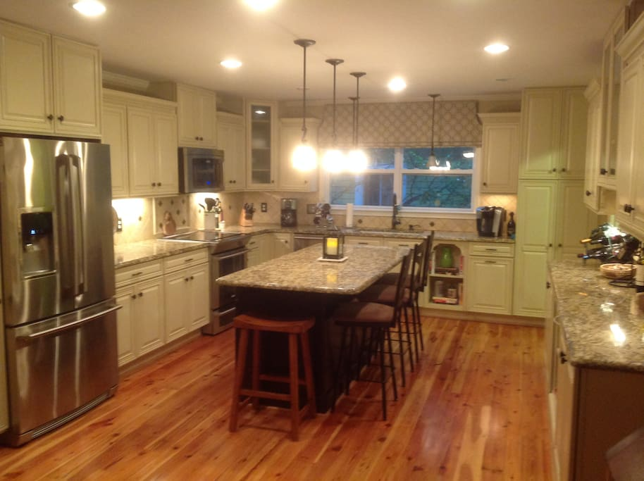 Spacious kitchen with seating for 4.