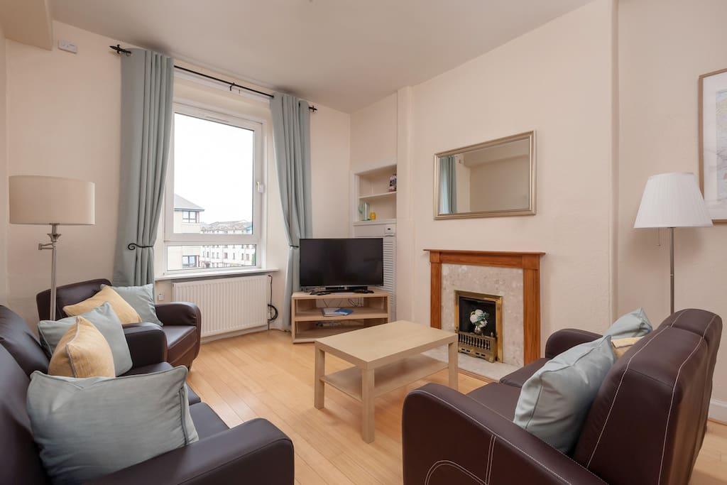 Spacious Lounge/Dining/Work Area complete with Smart TV, Wi-fi and sofa bed