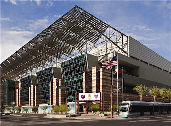 Phoenix Convention center is 7-10 minutes away by light rail or car