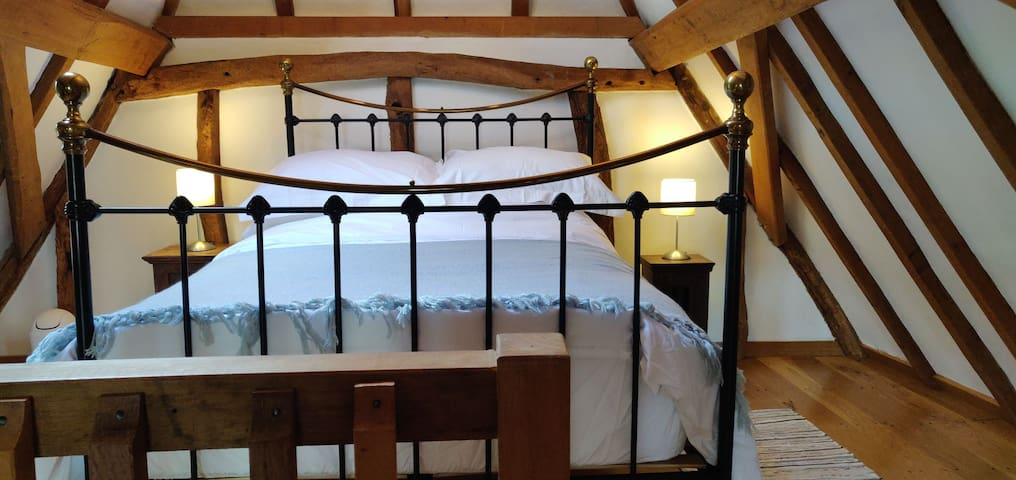 Cosy double bedroom looking out onto the mature trees and garden, church right next door.