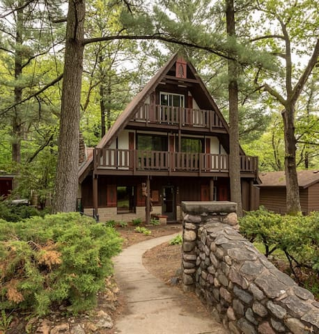 Unique chalet style home tucked in the woods, but right in town!