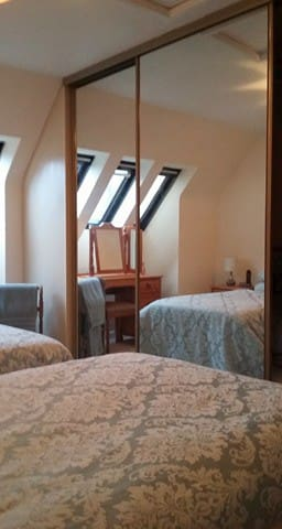 Bedroom upstairs - Twin beds, with double mirror glazed wardrobe., 2 bedside tables and an extension lead to charge phones etc.