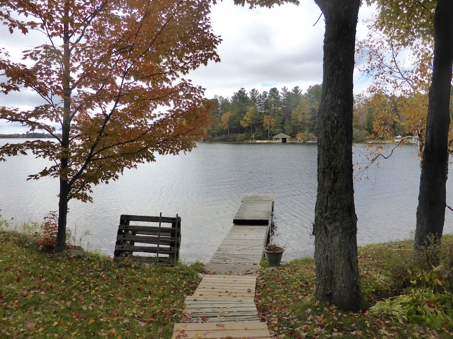 Looking down dock to lake in autumn.