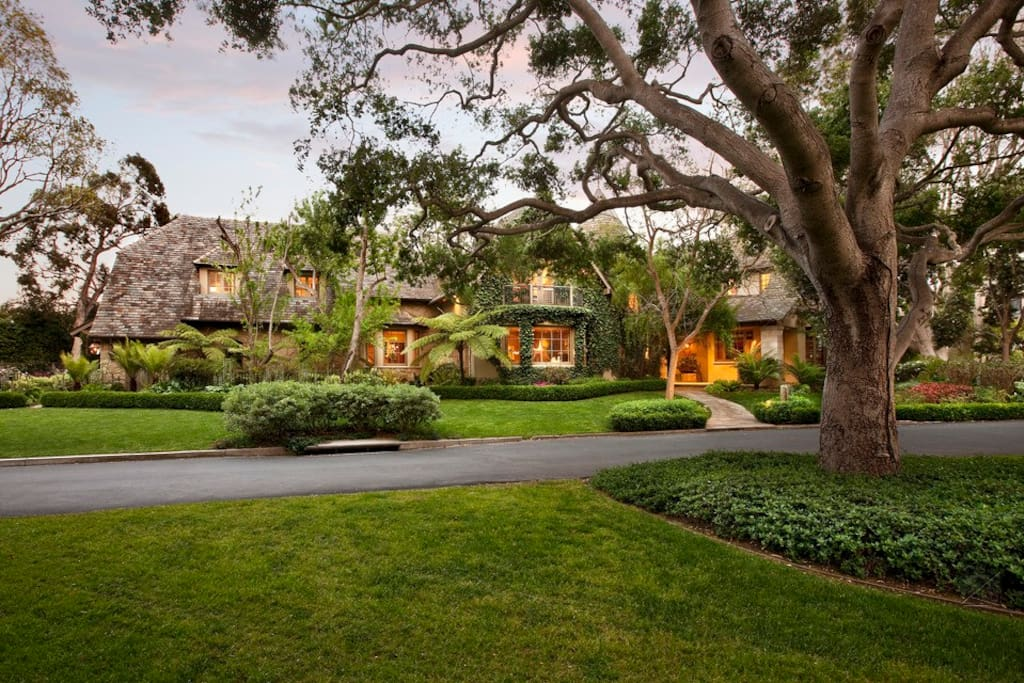 This French Normandy style home is adorned by beautifully landscaped grounds with tropical foliage. It's located in the prestigious gated community of Sea Meadow in Montecito.