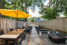 Private patio with privacy fence and automatic back gate (space to park your car inside gate). Soak up the sun all day and cozy up fireside to end the night.