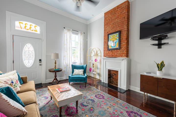 Jewel-box shotgun with queen-size sofa sleeper, ceiling fans and closed brick fireplace