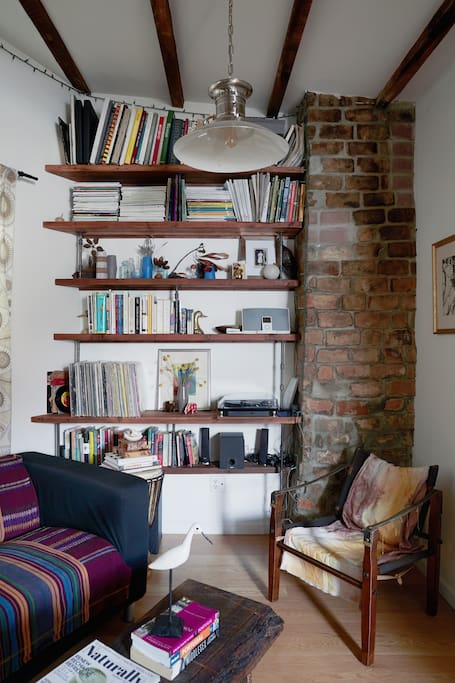 Living room space w/books & records