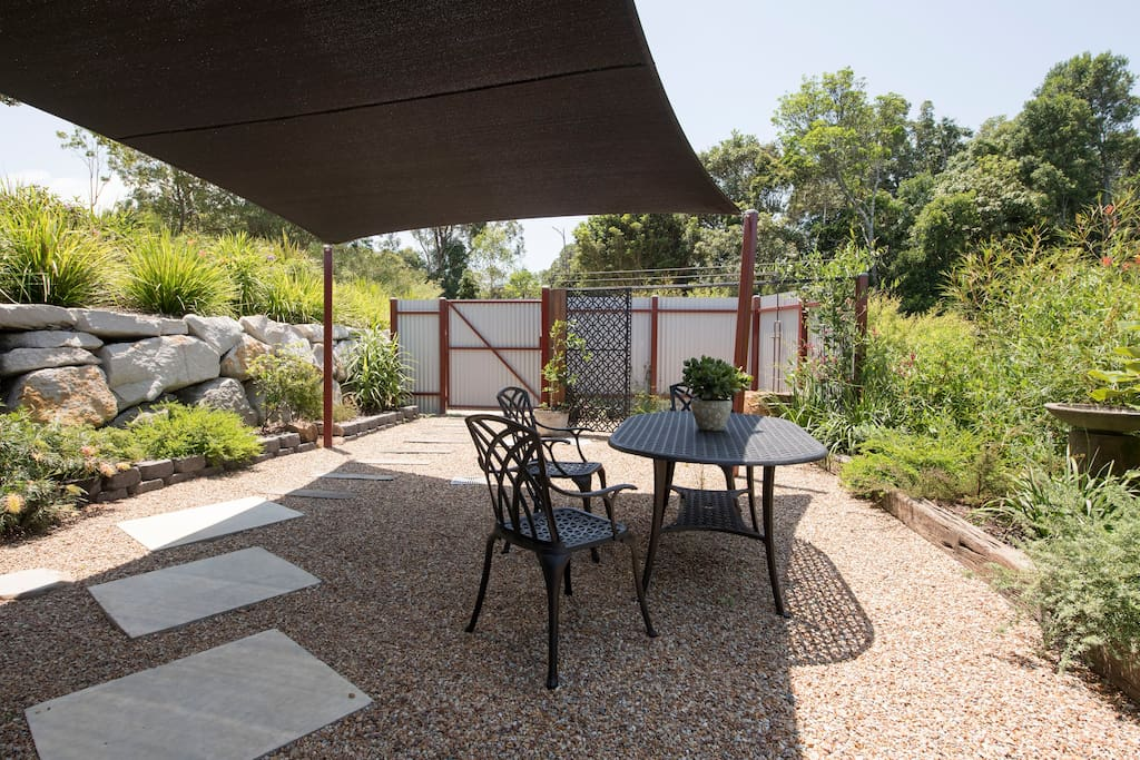 Private Hot water shower area with shaded outdoor entertainment setting.