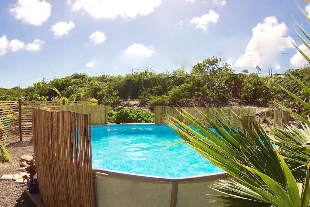 Poinciana Place Providenciales -Large 18ft x 4.5ft Pool in Back yard, Hammock, BBQ Grill, Picnic Table
