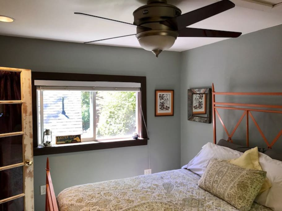 Bedroom with two big windows w/ screens