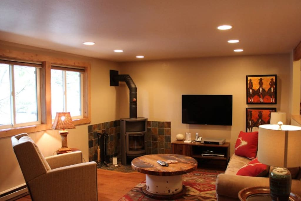Cozy up in the den with a wood burning fireplace and a big screen TV. Watch the snow fall out the window in the winter or open the windows for some fresh air in the summer.