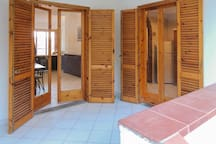 Doors opening to terrace and garden from living/dining room and kitchen
