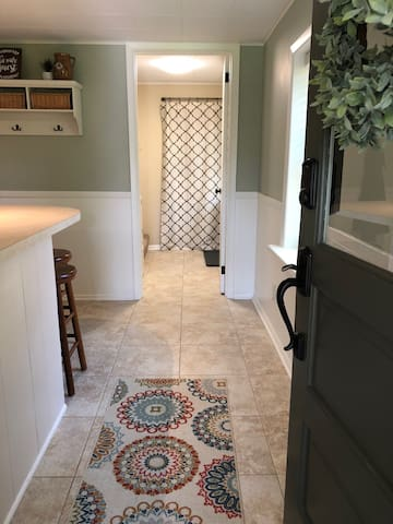 Front door entrance, into the full size kitchen.