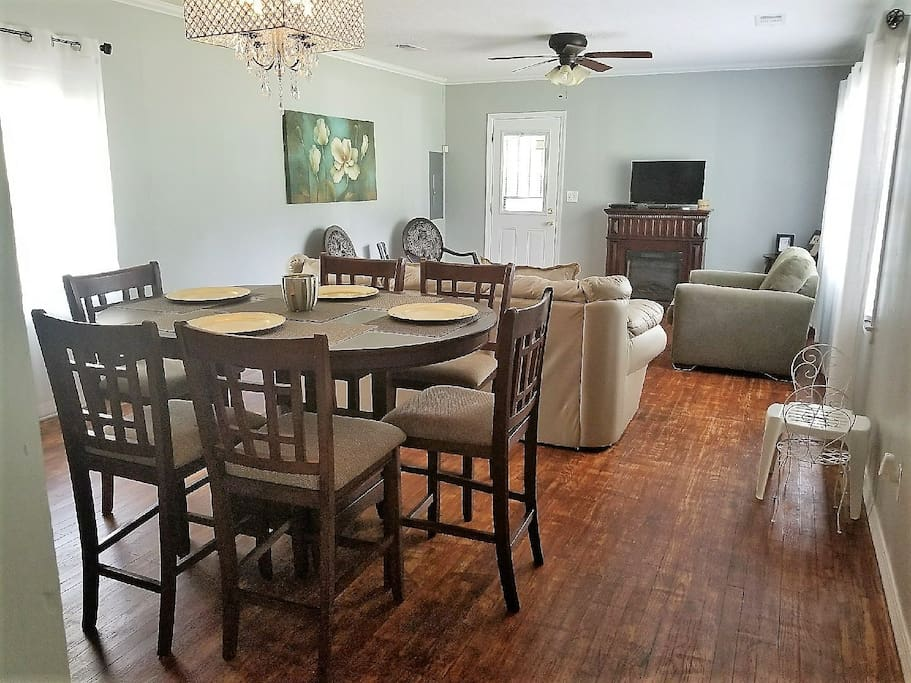 Dining room/ Living room. Very open. There is even seating for the little ones! The tv has a brand new fire stick- watch Netflix and sling tv.