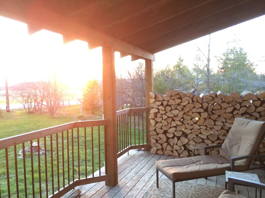 Home offers a large west-facing front porch and a yard with a fire pit.
