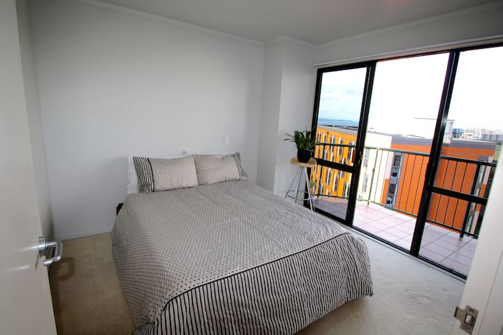 Main Bedroom: Queen Sized Bed, Access to Balcony and Walk in Closet