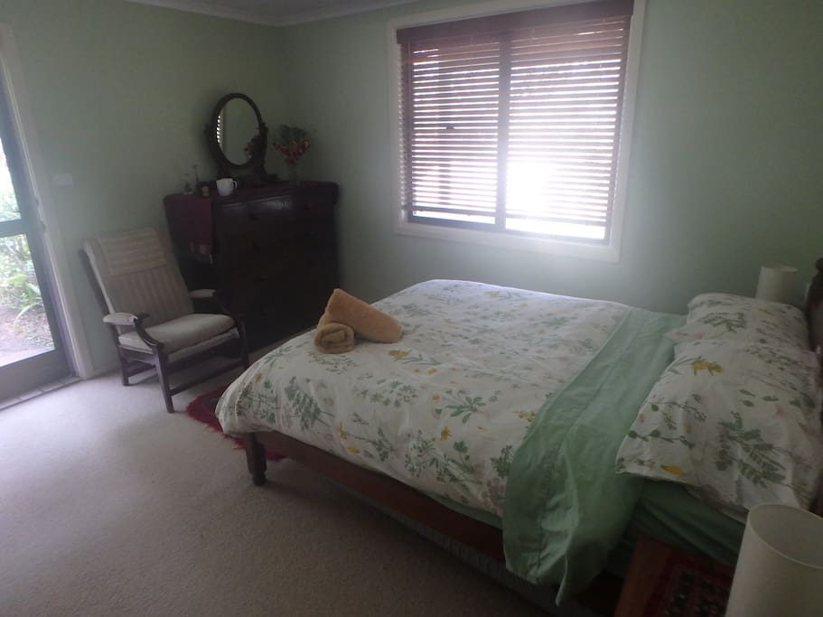Bedroom with chest of drawers and chair