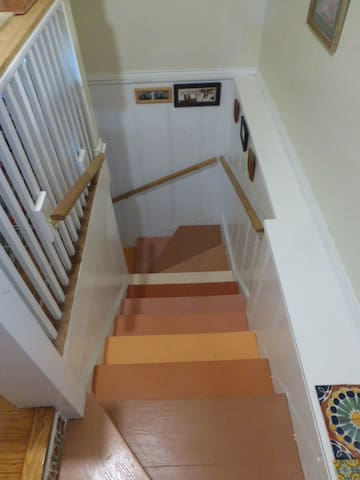 Hall stairs to downstairs kitchen.