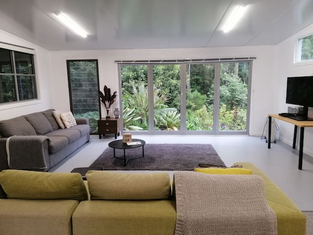 Living room with forest outlook