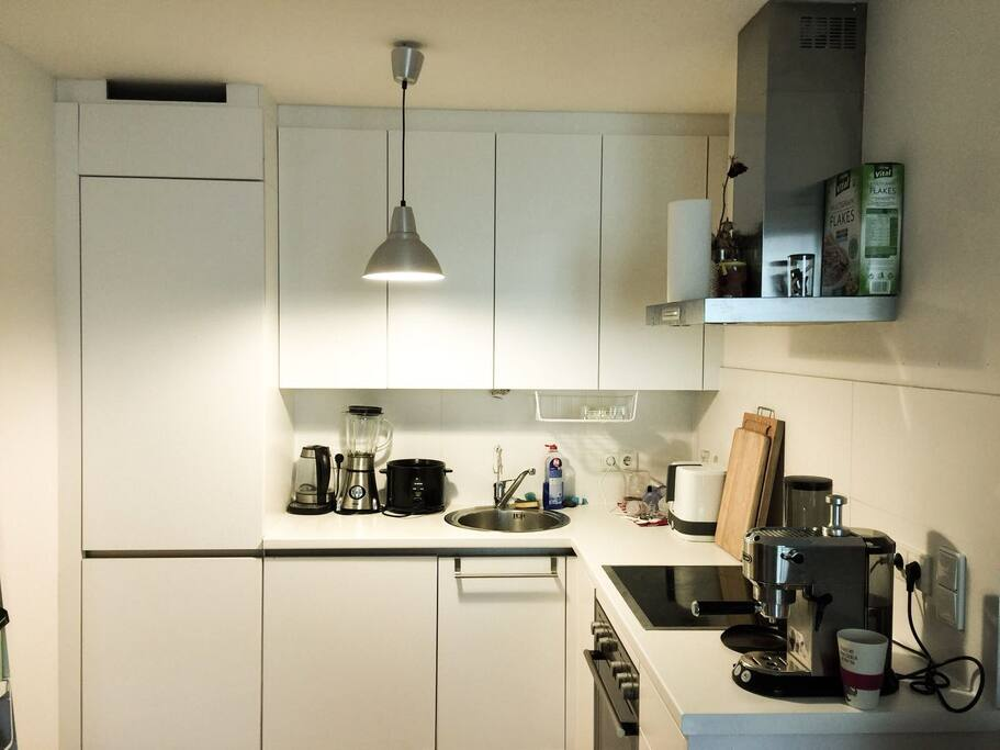 Kitchen. Fully equipped with stove, water kettle, espresso machine, cutlery, and everything you need to cook a delicious meal.