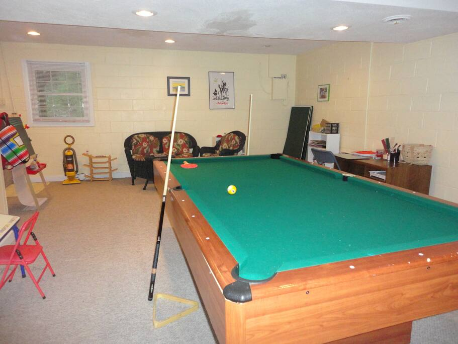 Basement room with pool table and ping pong table.