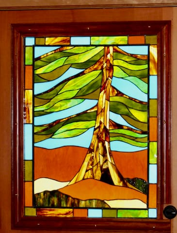 Stained glass front door for privacy.