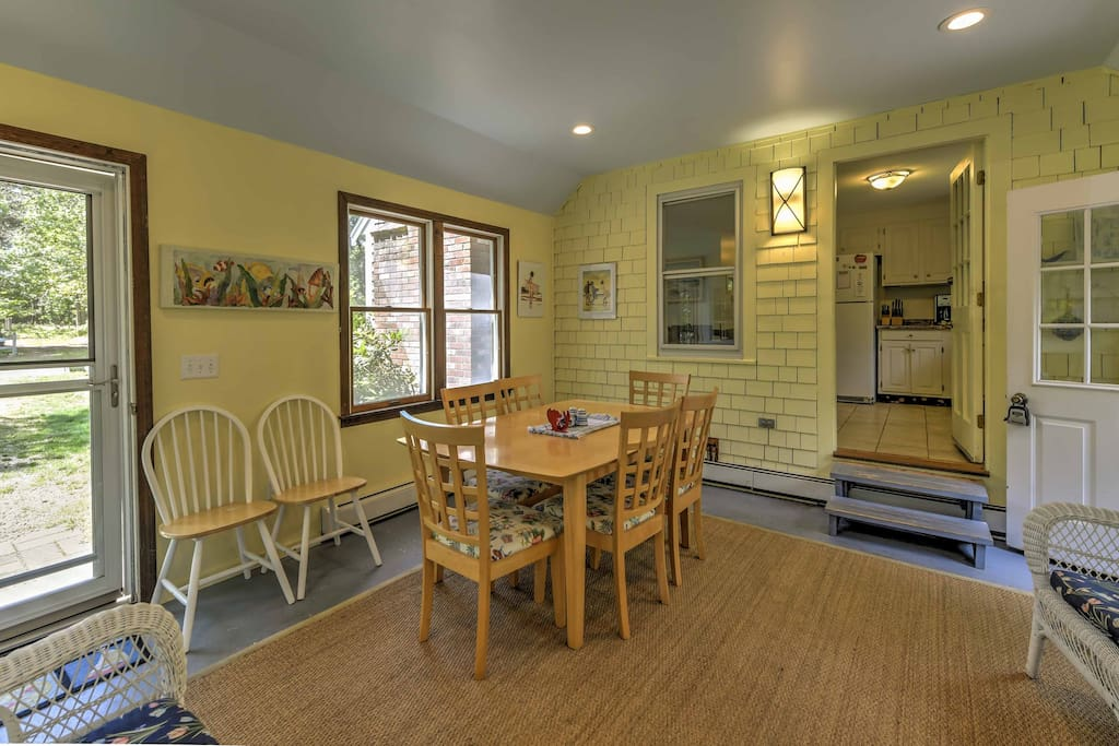 Enjoy a breezy lunch in this sunroom just off the kitchen.