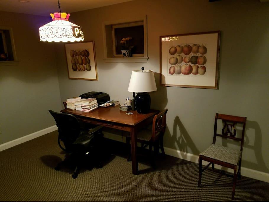 Basement living room with desk.