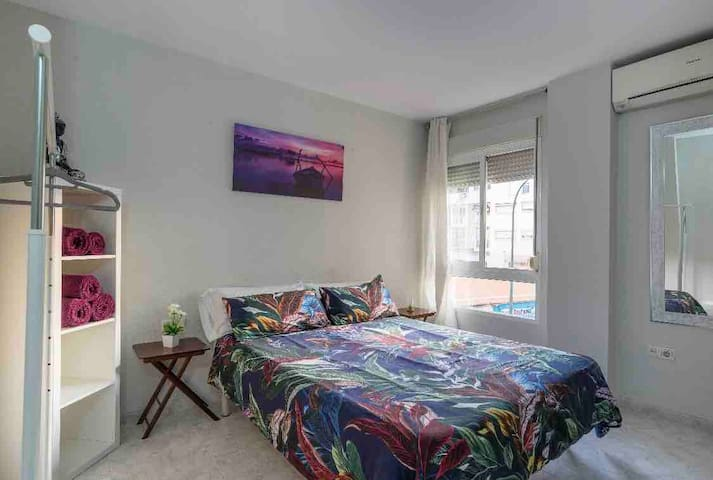Double bed in a quiet and bright place + bathroom