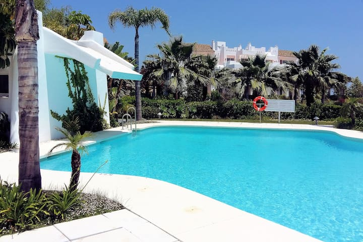 Modern apartment with  paradise lagoon, private garden and 4 km from the sea