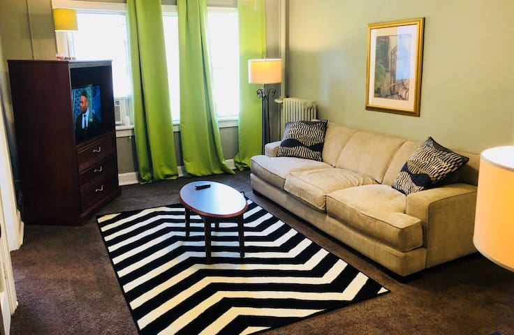 Comfy living room, with a nice homey feel.