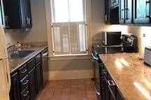 The kitchen with granite counters.