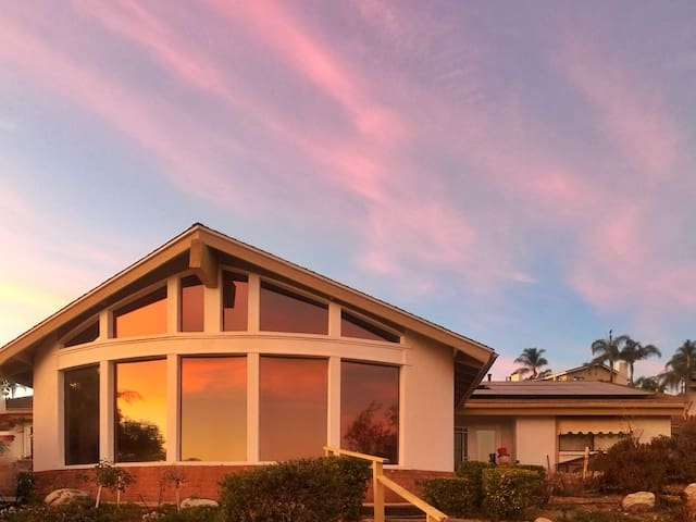 NOT AIRBNB HOUSE. Beautiful sunset reflecting on the main house.