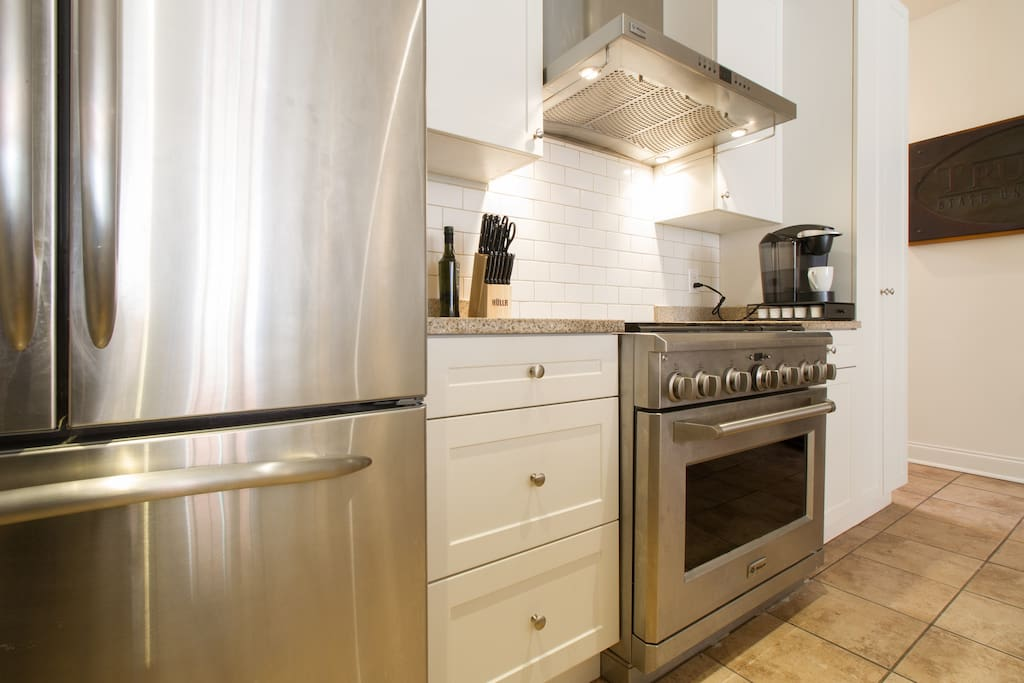 The large and beautifully equipped kitchen is perfect for prepping meals and entertaining.