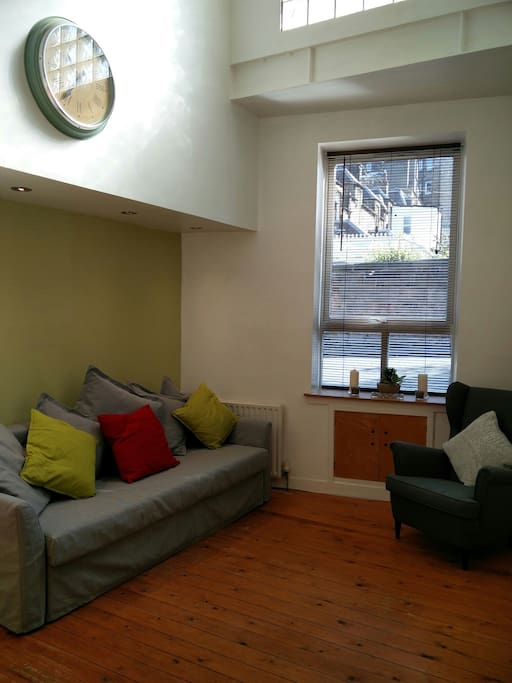 Bright living area with sofa bed