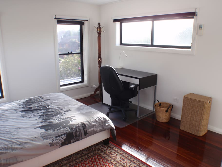 Guest bedroom with desk and office chair