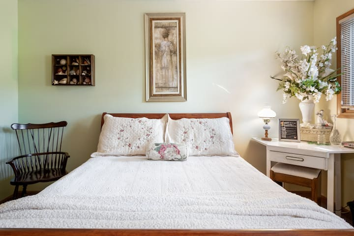 Sleigh Bed Master Queen comfort with windowed ptivate views of your mountainside forrest where a simple vanity desk is yours.