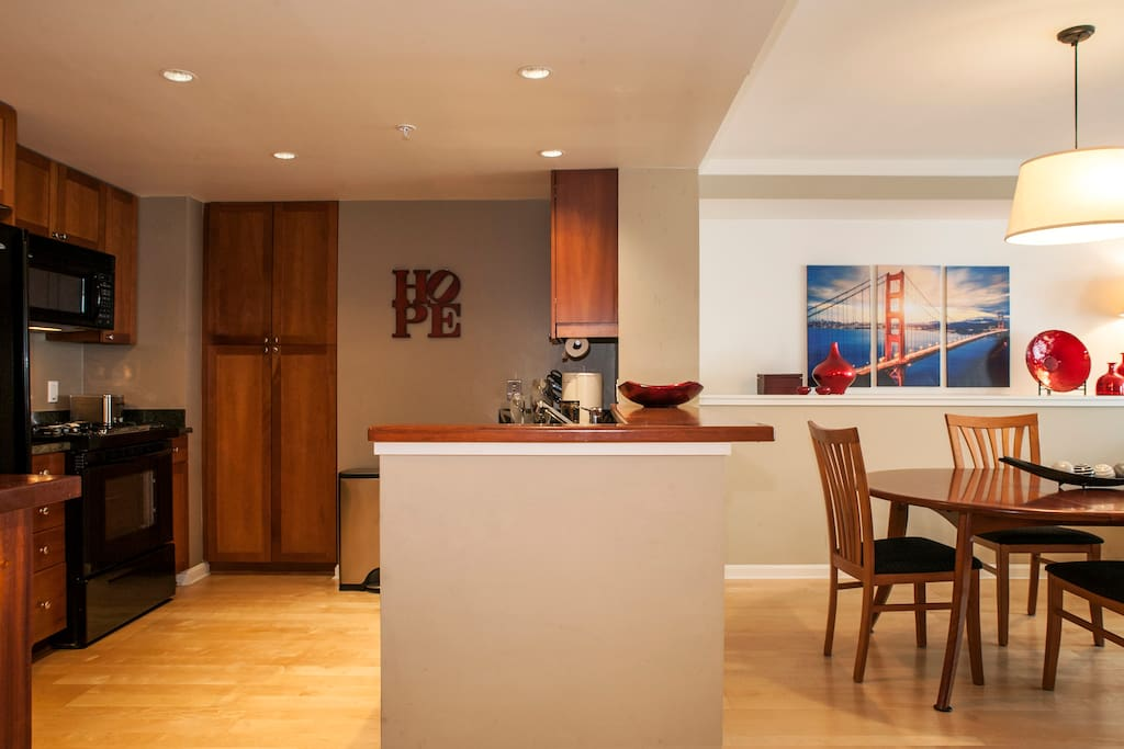 Here is a view of the cherry countertop in the kitchen and the cherry cabinets in the kitchen.