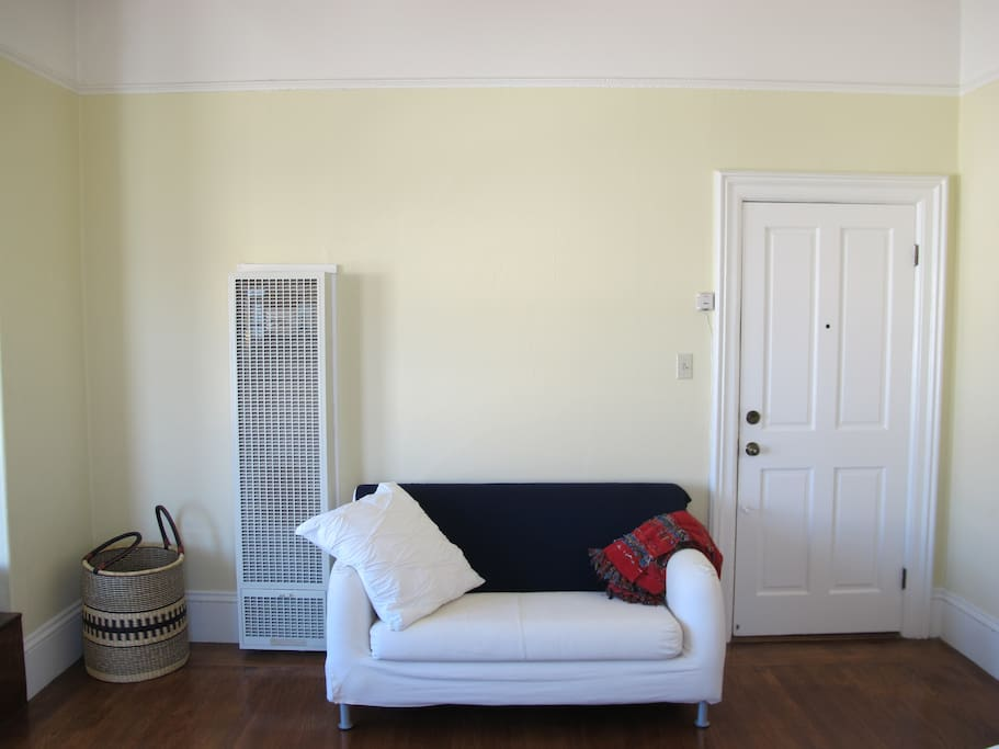 Main room with heater and loveseat sofa