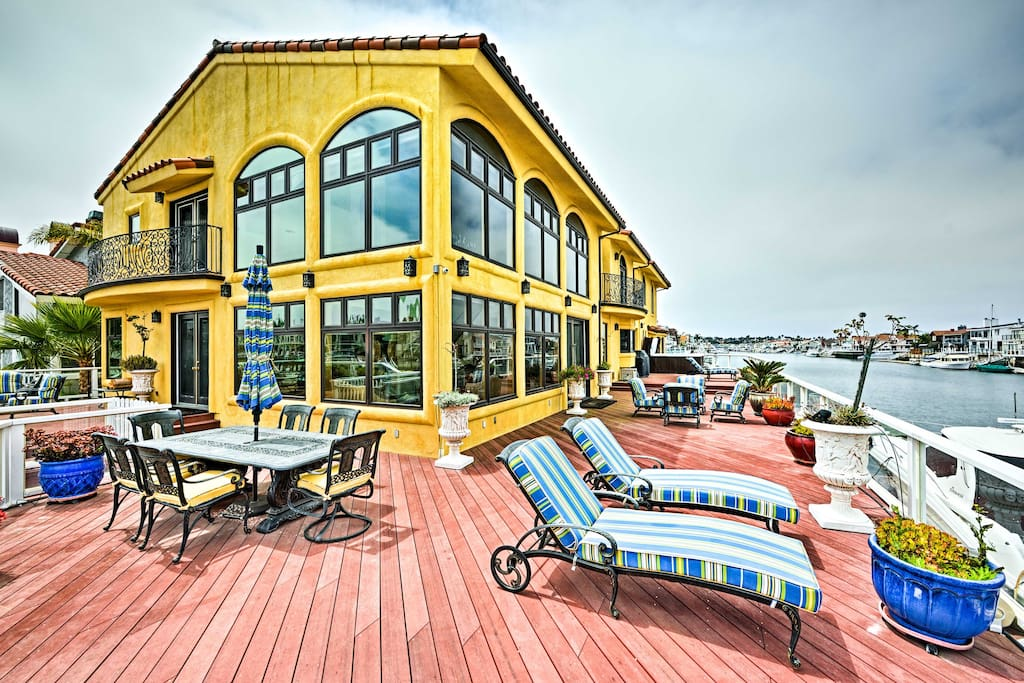 8 guests will love the wraparound deck with outdoor furniture and private dock.