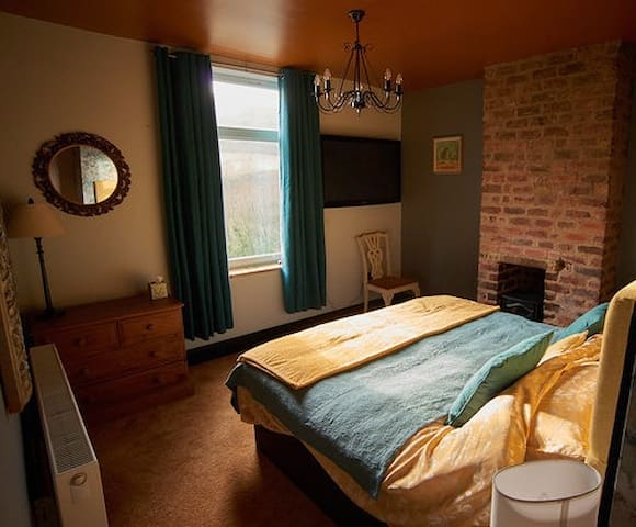 Main bedroom with Super King 6ft very comfortable Pocket Sprung bed. TV included and hair dryer. Great view of valley over Hebden Bridge.