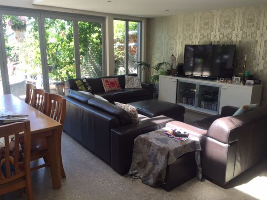 Large lounge area with open plan kitchen, dining and outdoor area