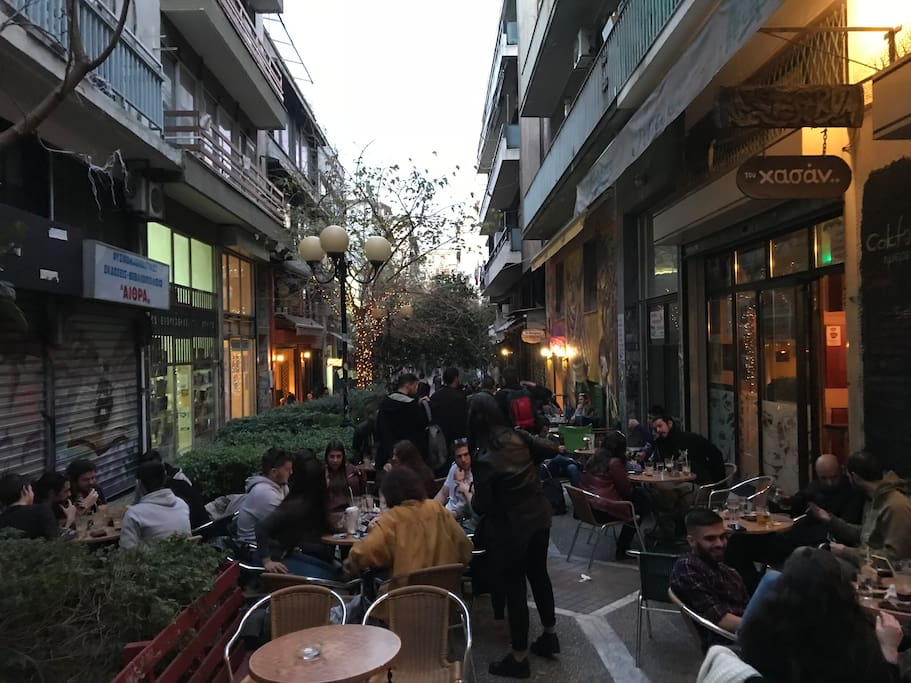 Coffee shops and bars just under your legs. The heart of Exarchia is here
