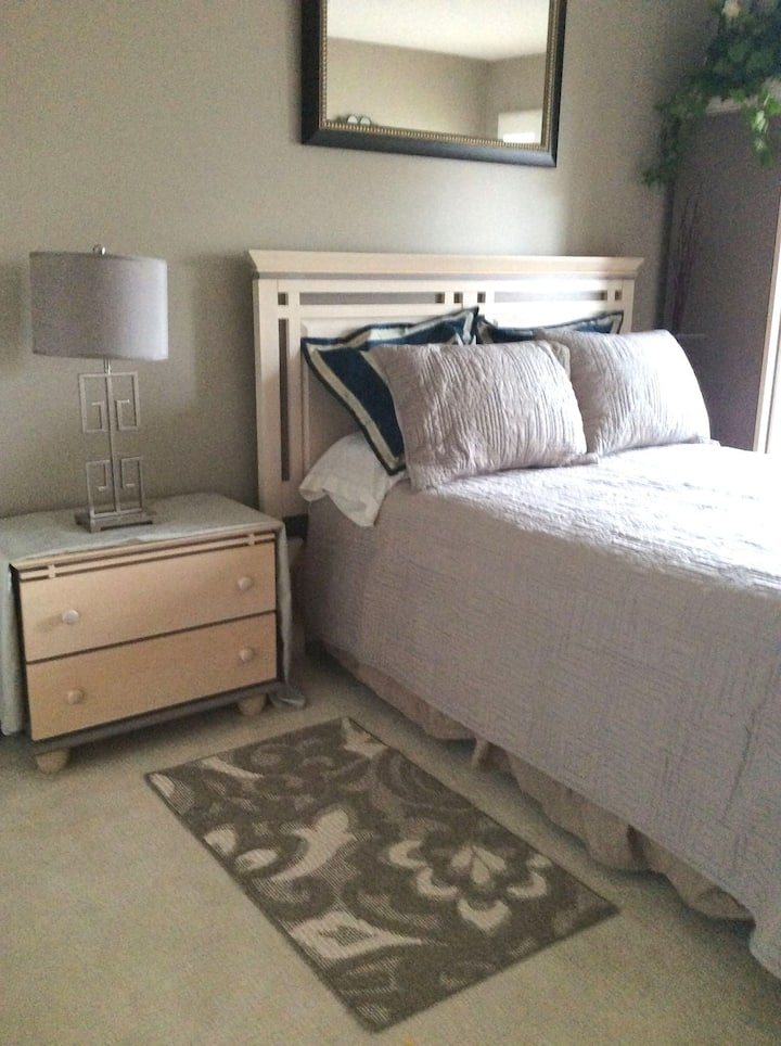 Spacious Oakville bedroom with private bathroom
