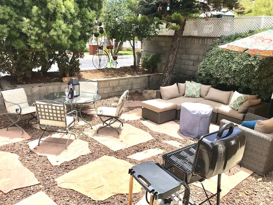 Shared patio with fire pit and propane grill