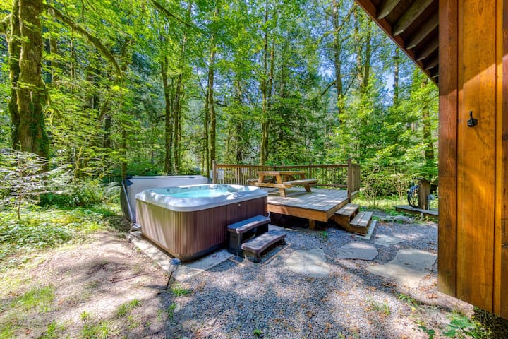 Two classic cabins w/ private hot tubs, decks & gorgeous woodland views!