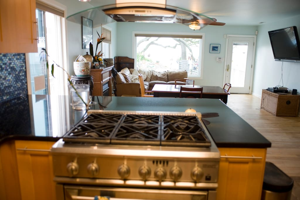 Newly renovated kitchen with gas stove top.