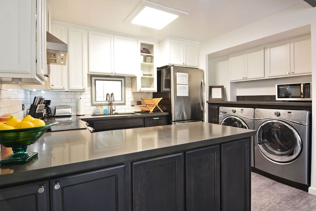 Meals are made easy in our Full Kitchen equipped with high-end appliances including fridge and freezer, microwave, kettle, coffee maker, toaster and a washing machine and steam dryer.